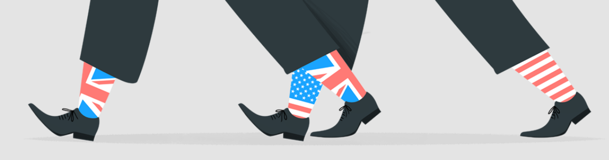 Feet walking wearing socks with American and UK flags on