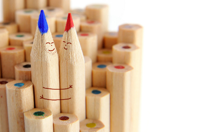 Animated blue and red crayon in a smiling embrace